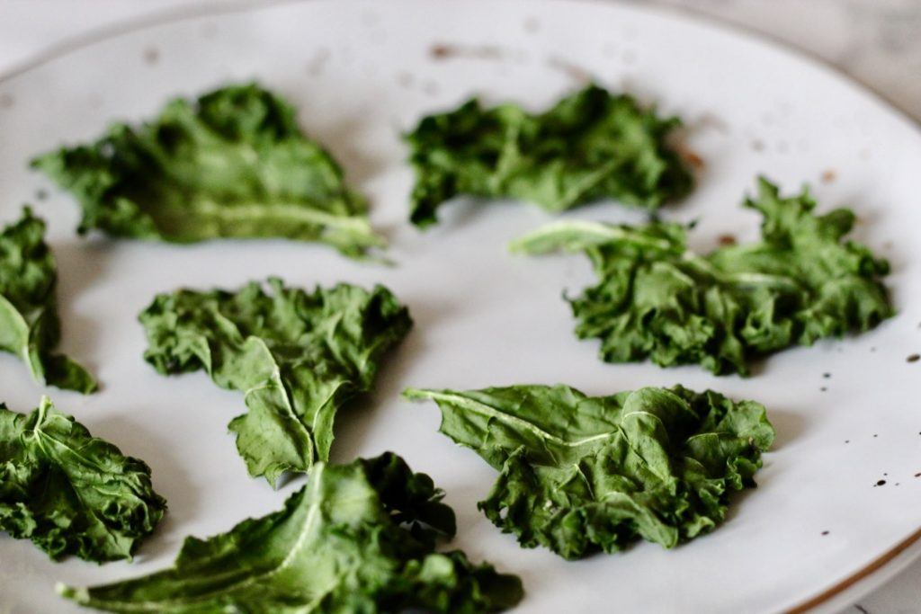 3 Minute Microwave Kale Chips. Too good to be true? I thought so too. But these chips are the perfect crispy addition to salads or a quick, healthy snack for your day.