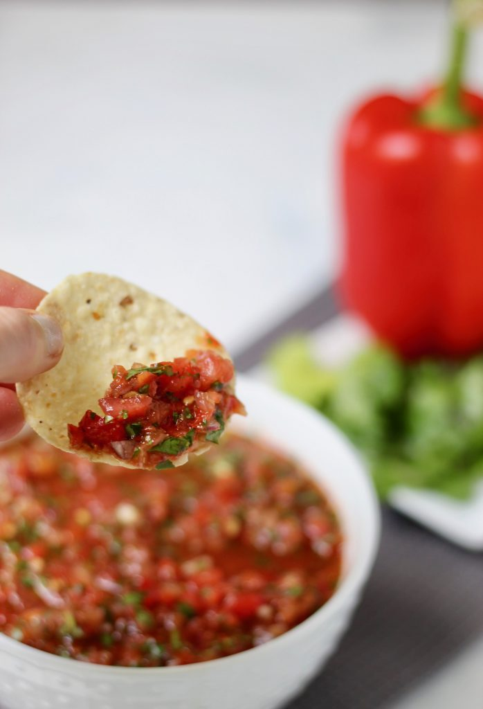 This secret ingredient salsa is filled with fresh ingredients bursting with authentic flavor. Throw everything into a blender and have on the table in 10 minutes or less! Vegan and gluten-free.