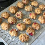 This healthy cranberry orange carrot cookies recipe features fresh cranberries, whole grain flour, carrots, and a delicious glaze on top