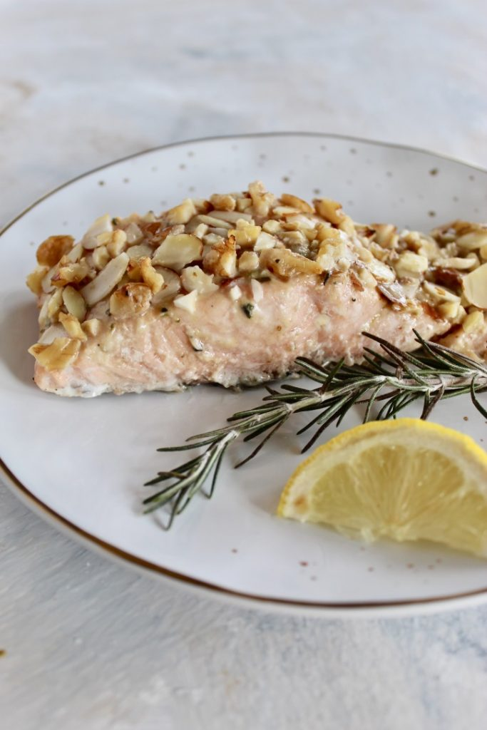 This simple nut crusted salmon takes just 5 minutes to whip up and is on the table in under 30 minutes! The honey mustard glaze topped with nuts is the perfect combination of sweet and savory