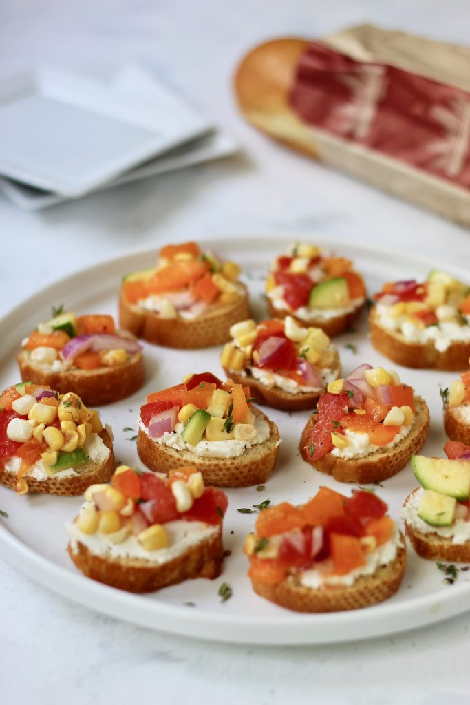 This veggie-filled Fresh Farmers Market Bruschetta is the perfect party appetizer, side dish, or colorful meal. Customize it your way to make it gluten-free, dairy-free, or vegan! #seasonal #summerveggies #bruschetta #farmersmarket #CheerfulChoices