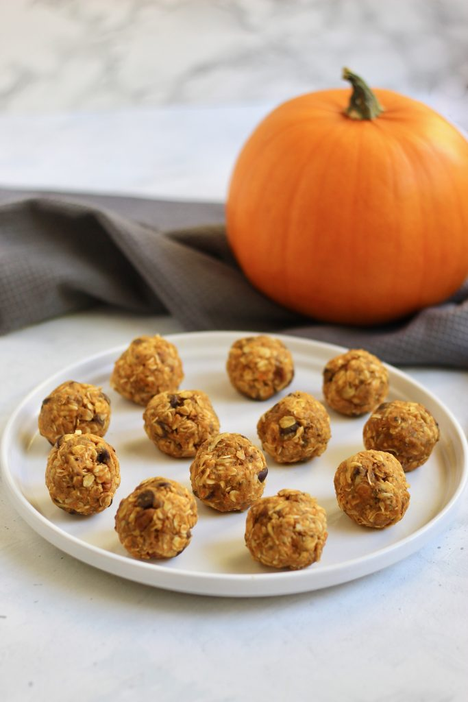These seasonal pumpkin energy bites are a perfect snack to make for a busy week or holiday party. They are customizable and take 5 minutes or less to make! #vegan #glutenfree #energybites #pumpkinrecipes #healthysnack #CheerfulChoices