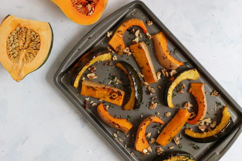 Create a beautiful side dish with this 5-ingredient recipe for maple roasted squash wedges. Perfect for Thanksgiving and the holidays! Customize and use any winter squash or pumpkin of your choice. #holidaysidedish #squashwedges #vegan #glutenfree #CheerfulChoices