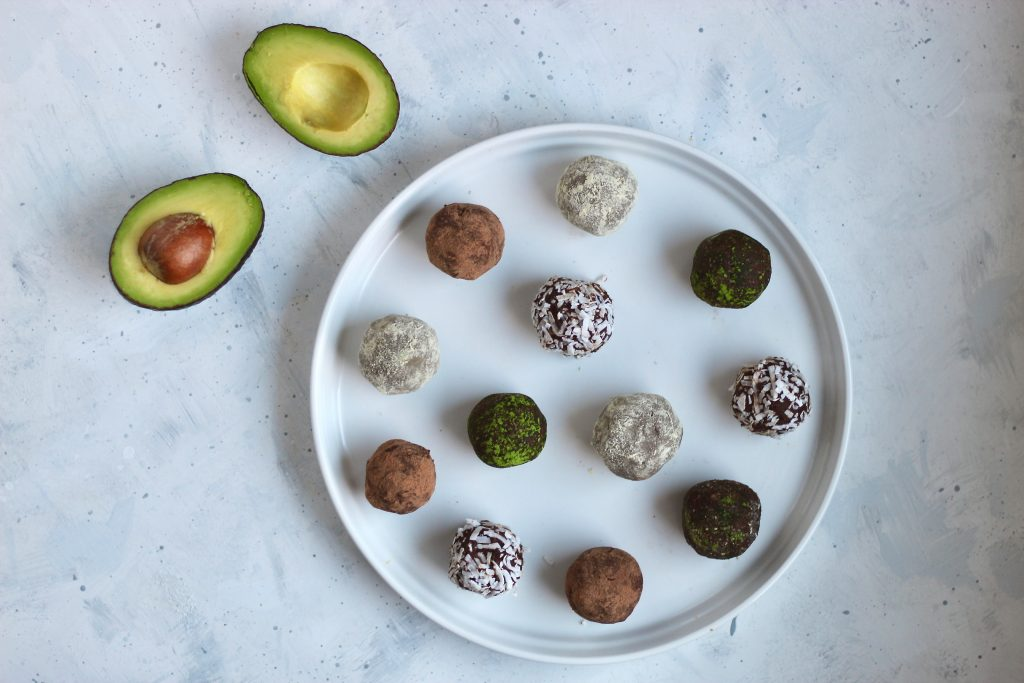 These 3-ingredient dark chocolate avocado truffles are completely customizable and take under 20 minutes to make. Perfect to bring to your next party or add to your holiday dessert table. #vegan #glutenfree #healthydessert #holiday #CheerfulChoices