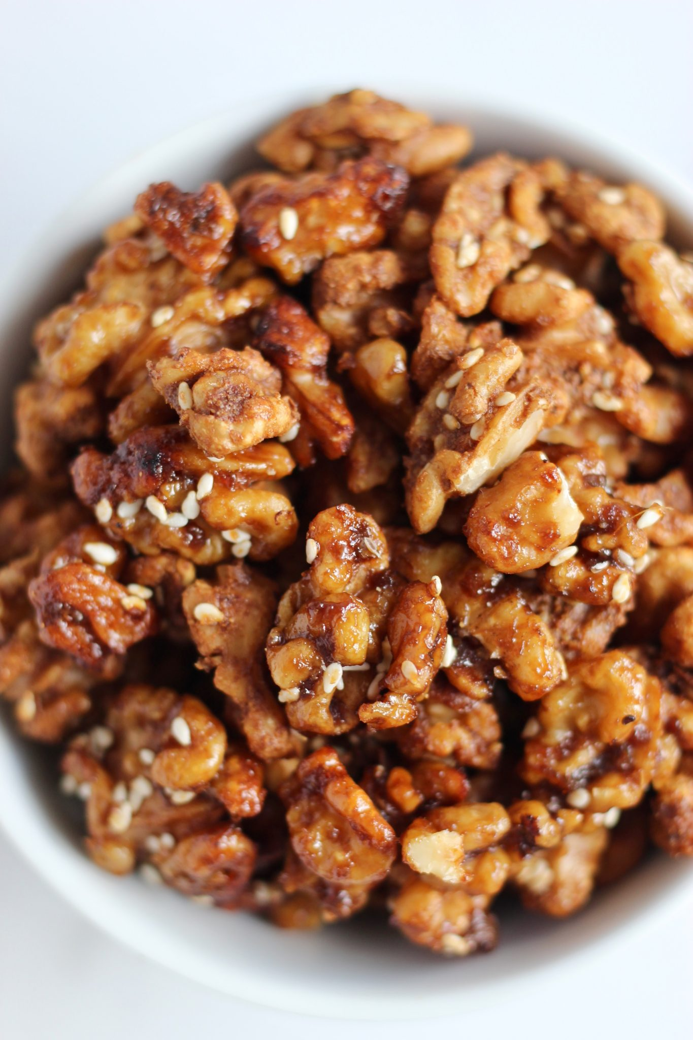 These crunchy soy glazed walnuts are the perfect savory bite to snack on at home. They are seriously so easy to make and call for just a few simple pantry ingredients and spices. Recipe includes vegan and gluten-free friendly options. #PantryRecipe #Sponsored #WalnutsSweetOrSavory @CaWalnuts